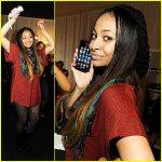 Raven Symone avec l'iPhone et la Wii