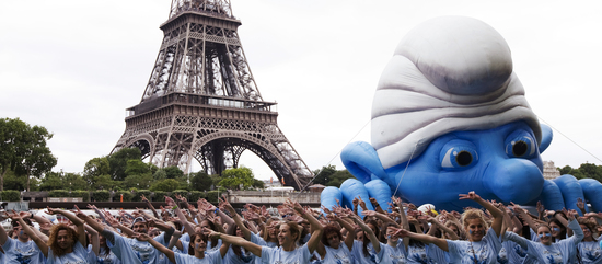 "Participants dance as they attend a flash mob global Smurfs Day"" in Paris"