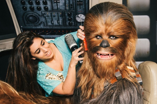 Hair stylist Caryn Mitman brushes Chewbacca's hair as finishing touches are put on the experience Star Wars at Madame Tussauds Launch, London, Britain - 12 May 2015 Fans came face-to-face with some of the biggest heros and villains from the Star Wars universe today, when Madame Tussauds London gave a sneak peak of its major new experience, which allows fans to step right into scenes covering a galaxy of locations. Officially opening this Saturday (May 16, 2015), the new experience represents a significant expansion at the world famous attraction and has been created in close collaboration with Disney and Lucasfilm. (Rex Features via AP Images)